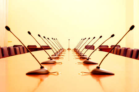 Photo of empty conference room with microphones  Stock Photo
