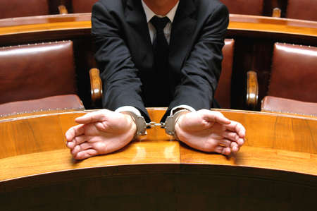businessman in the judicial process with handcuffs
