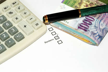 Checkbox with pen, calculator and money isolated on white