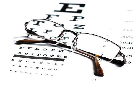 Eyeglasses on the Snellen Chart Stock Photo