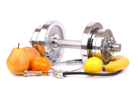 dumbbell, fruit, syringe, doctor headset and fruits on white background Stock Photo