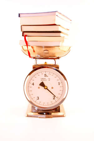 a pile of books on a scale, white background Stock Photo - 12541078