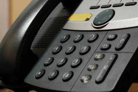 photo of black telephone on dark background