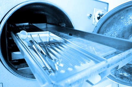 photo of dental tools in sterilizer, blue tone