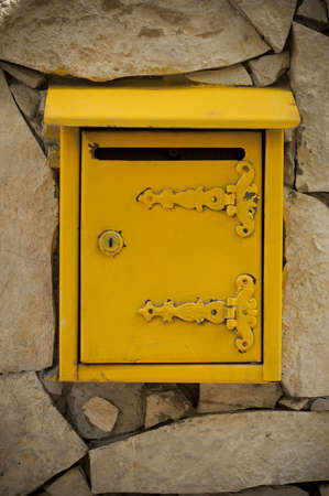 Yellow mailbox on the stone wall, Serbian model