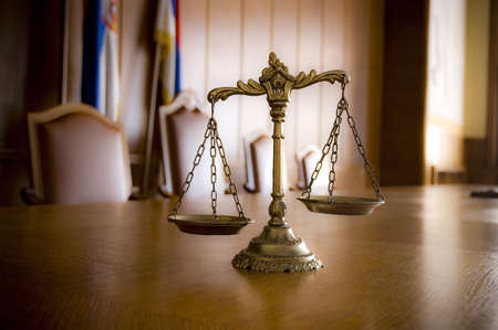 antique weight scale: Symbol of law and justice in the empty courtroom, law and justice concept