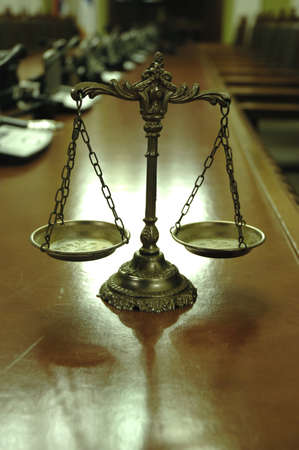 Symbol of law and justice in the empty conference room with microphones, law and justice concept photo