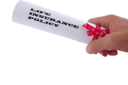 financial insurance: Life insurance policy in the hand on white background