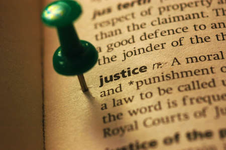 Dictionary definition of justice  Close-up view, with paper textures,  Stock Photo