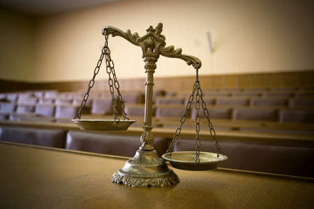 Symbol of law and justice in the empty courtroom, law and justice concept photo