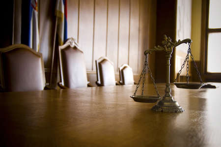 justice: Symbol of law and justice in the empty courtroom, law and justice concept