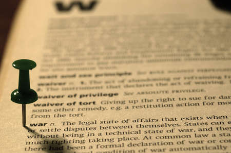 differential focus: Dictionary definition of War  Close-up view, with paper textures, sepia tone Stock Photo