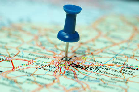 centred: push pin stuck on a map centred on the city of Paris, Capital of the art world Stock Photo