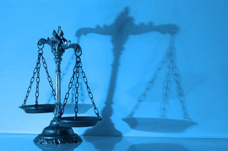 Symbol of law and justice with shadow, law and justice concept,blue tone Stock Photo