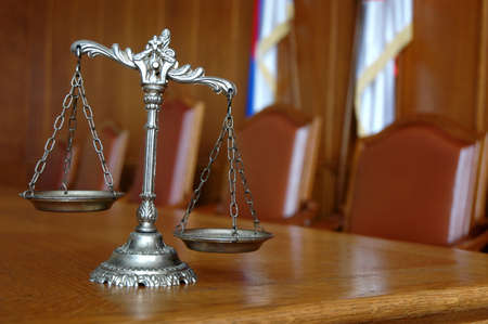 court: Symbol of law and justice on the table, law and justice concept, focus on the scales Stock Photo