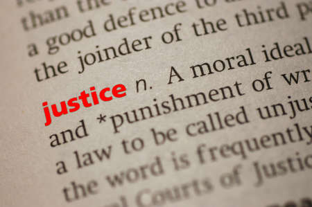 Dictionary definition of Justice  Close-up view, with  paper textures