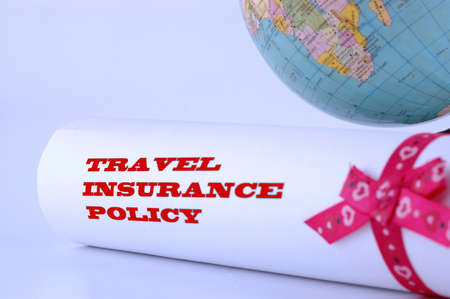 A travel insurance policy with globe on the blue light background, insurance concept, SOFT FOCUS