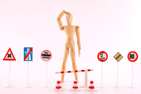 Wooden doll surrounded by signs of restriction, concept of limitation freedom Stock Photo