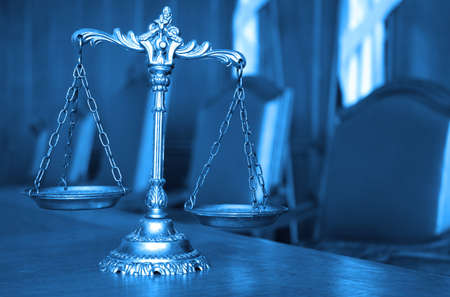 Symbol of law and justice on the table, law and justice concept, blue tone photo