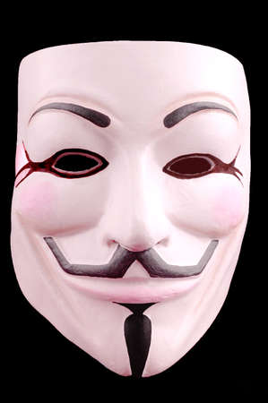 guy fawkes mask: Anonymous face mask on the black background, known as Guy Fawkes Mask from the movie V for Vendetta. Concept of anti-global movement