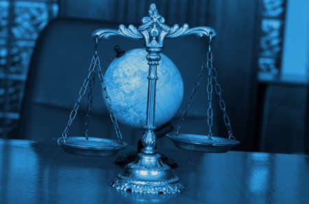 Symbol of law and justice with globe, law and justice concept, blue tone
