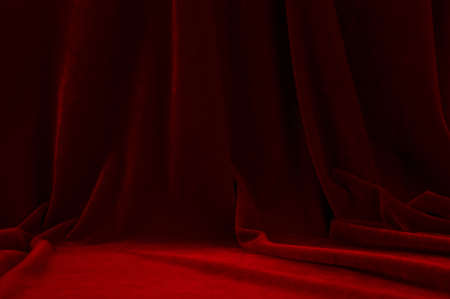 Red velvet theater curtain on a stage