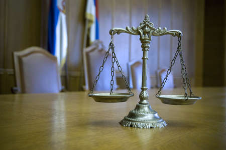 legal scales: Symbol of law and justice in the empty courtroom, law and justice concept, focus on the scales