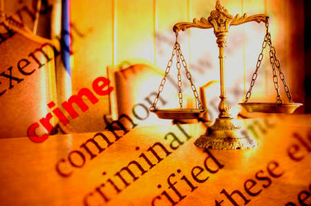 criminal law: Dictionary definition of crime and Decorative Scales of Justice