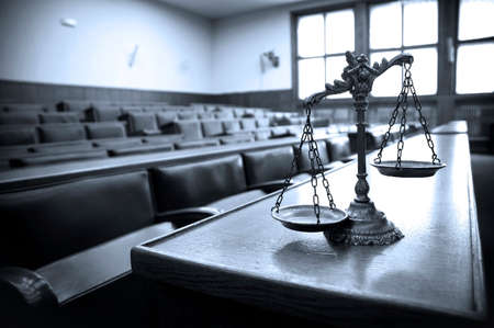 trial: Symbol of law and justice in the empty courtroom, law and justice concept, blue tone Stock Photo
