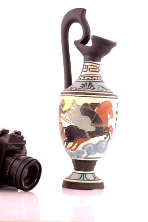 Ancient Greek vase and camera isolated on white photo