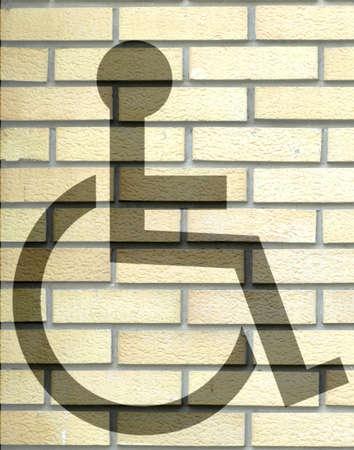 handicap sign: Handicap sign on the yellow brick wall