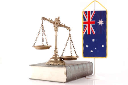 Decorative Scales of Justice on the book with Australian flag on white  Law and order concept photo
