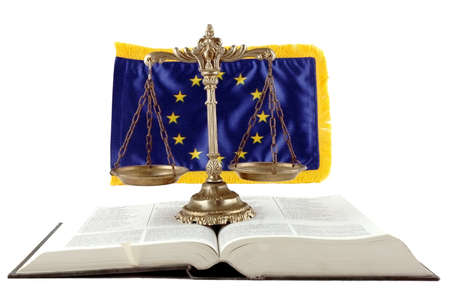 Decorative Scales of Justice, book and EU flag on the white background