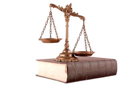 Decorative Scales of Justice on the book, isolated on white  Law and order concept Stock Photo