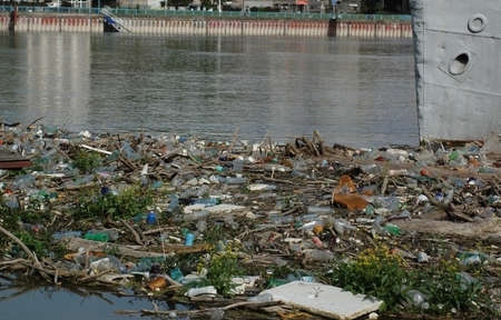 polluted river: garbage and plastic bottles on the river