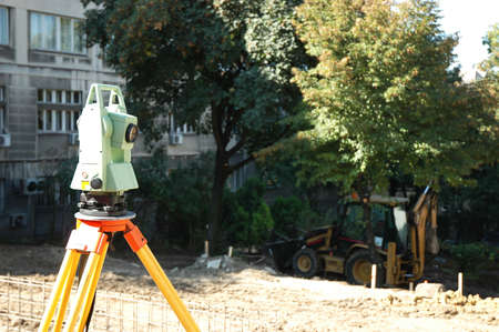 geodetic: Geodetic instrument used for surveillance on the construction site Stock Photo