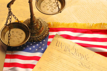 United States Constitution, scales of justice and American flag Stock Photo