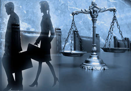 verdicts: Silhouette of Two lawyers with decorative scales of justice, blue tone