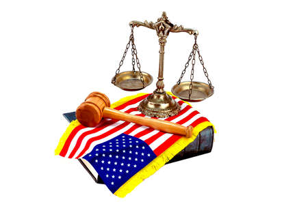 Decorative Scales of Justice on the book with American flag and gavel on white. Law and order concept photo
