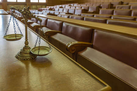 Symbol of law and justice in the empty courtroom, law and justice concept, focus on the scales photo