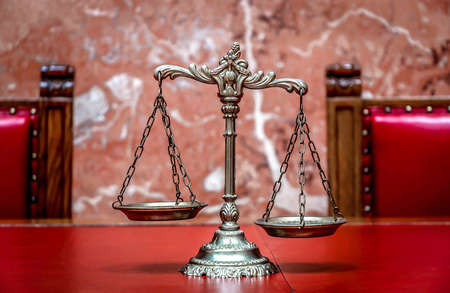 justice balance: Symbol of law and justice on the red table, law and justice concept, focus on the scales Stock Photo