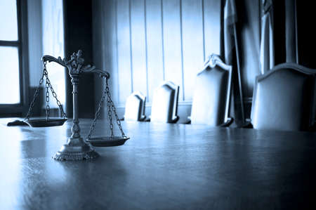 law scale: Symbol of law and justice in the empty courtroom, law and justice concept, BLUE TONE