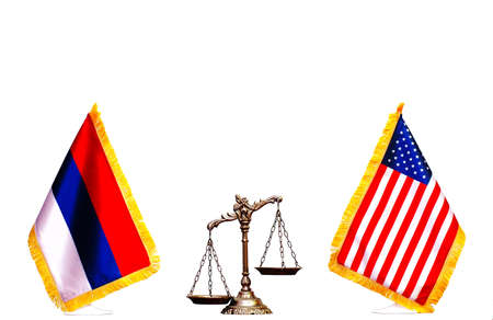 russian flag: Scales of justice between American and Russian flag on the white background
