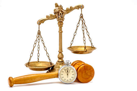 Old silver stopwatch, wooden gavel and decorative scales of justice on the white background, focus on the gavel and stopwatch Stockfoto