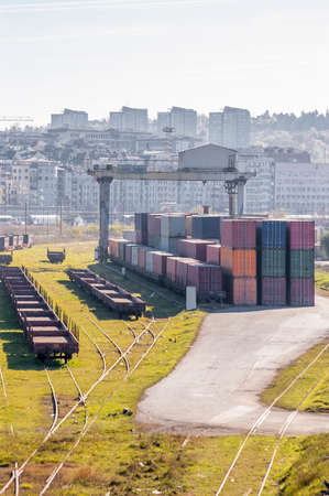 depot: Cargo train platform with freight train container at depot Stock Photo