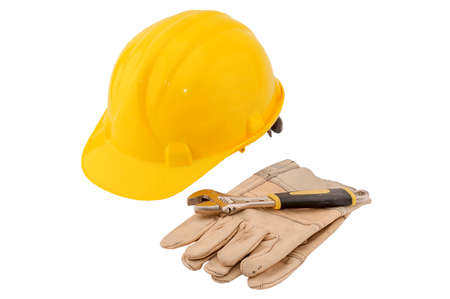spaner: Yellow helmet, glove and spaner on white background, concept of reconstruction flats and houses