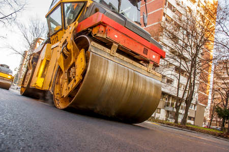 asphalting: Steamroller asphalting city roads