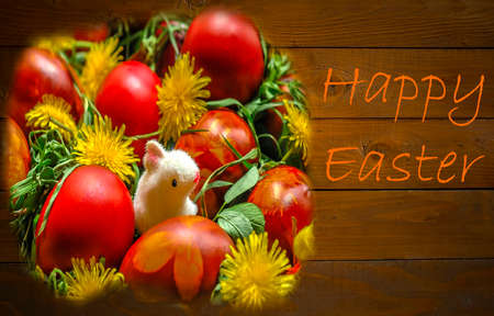 bonny: Basket with Easter egs, with herbs, flowers and bonny at a wodden background as a Happy Easter Card.