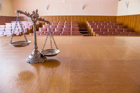 verdicts: Symbol of law and justice in the empty courtroom, law and justice concept, focus on the scales