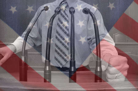 American politician making speech with fist , American flag background